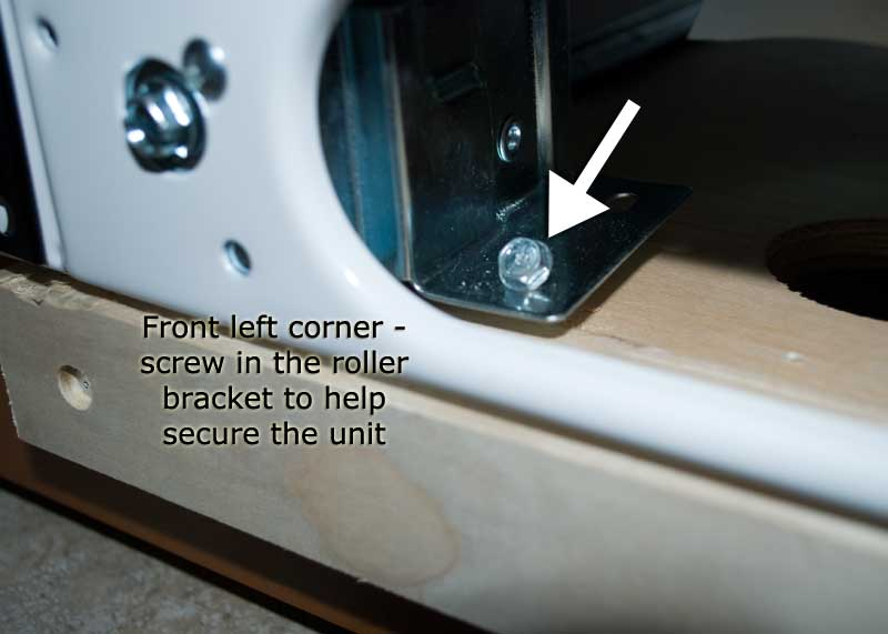 Screw into the front left corner of the roller plate